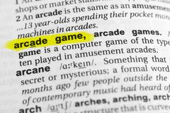 Highlighted English word `arcade game` and its definition in the dictionary.  Royalty Free Stock Image