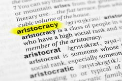 Highlighted English word `aristocracy` and its definition in the dictionary.  royalty free stock photo