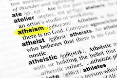 Highlighted English word `atheism` and its definition in the dictionary.  royalty free stock image
