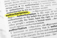 Highlighted English word `authoritarianism` and its definition in the dictionary.  royalty free stock image