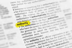 Highlighted English word & x22;authority& x22; and its definition at the dictionary.  Royalty Free Stock Photo