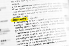 Highlighted English word & x22;autonomy& x22; and its definition at the dictionary. Highlighted English word & x22;autonomy& x22; and its definition at Stock Photo