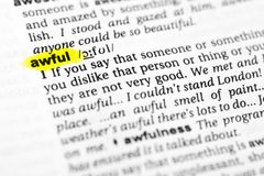 Highlighted English word `awful` and its definition in the dictionary.  stock photo