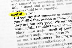 Highlighted English word `awful` and its definition in the dictionary.  royalty free stock photos