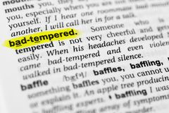 Highlighted English word `bad tempered` and its definition in the dictionary.  Royalty Free Stock Photography