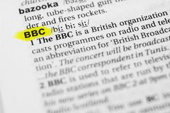 Highlighted English word `bbc` and its definition in the dictionary.  Stock Photo