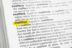 Highlighted English word & x22;coalition& x22; and its definition at the dictionary Stock Image
