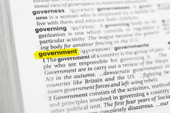 Highlighted English word & x22;government& x22; and its definition at the dictionary Stock Images