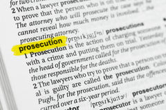 Highlighted English word & x22;prosecution& x22; and its definition at the dictionary Stock Photography