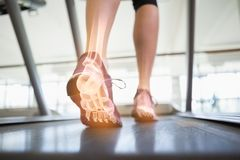 Highlighted foot bones of jogging woman royalty free stock images