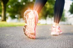 Highlighted foot bones of jogging woman. Digital composite of Highlighted foot bones of jogging woman stock images