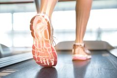 Highlighted foot of woman on treadmill Stock Images