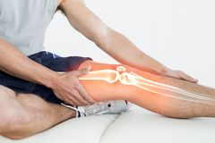 Highlighted knee of injured man. Digital composite of Highlighted knee of injured man royalty free stock image