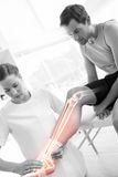 Highlighted knee of injured man at physiotherapist. Digital composite of Highlighted knee of injured men at physiotherapist stock images