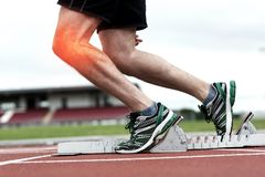 Highlighted knee of man about to race Stock Image