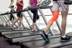 Highlighted knee of man on treadmill Royalty Free Stock Photography