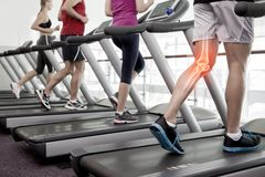 Highlighted knee of man on treadmill Royalty Free Stock Photo