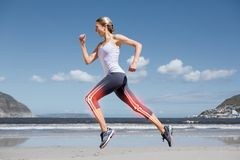 Highlighted leg bones of jogging woman on beach Royalty Free Stock Photo