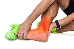 Highlighted leg of injured man against white background stock photos