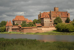 Highlighted Malbork castle. Malbork castle from opposite river bank eventually highlighted with the sun Stock Photo