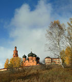 Highlighted Orthodox monastery on the background of clouds in autumn Royalty Free Stock Photo
