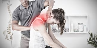 Composite image of highlighted pain. Highlighted pain against doctor doing neck adjustment royalty free stock photo
