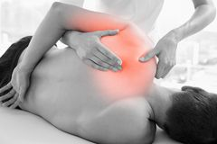Highlighted shoulder of man at physiotherapy Royalty Free Stock Image