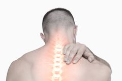 Highlighted shoulder pain of man Stock Photo