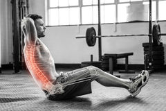 Highlighted spine of exercising man at gym. Digital composite of highlighted spine of exercising man at gym stock photo