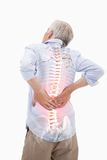 Highlighted spine of man with back pain. Digital composite of Highlighted spine of man with back pain royalty free stock photography