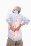 Highlighted spine of man with back pain. Digital composite of Highlighted spine of man with back pain Royalty Free Stock Photo