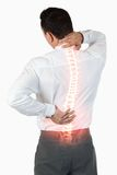 Highlighted spine of man with back pain. Digital composite of Highlighted spine of man with back pain Royalty Free Stock Photos