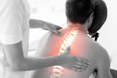 Highlighted spine of man at physiotherapy Stock Image