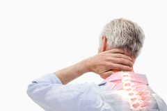 Highlighted spine pain of man Stock Photos