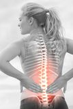Highlighted spine of woman with back pain Royalty Free Stock Photography