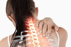 Highlighted spine of woman with neck pain Royalty Free Stock Image