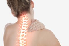 Highlighted spine of woman with neck pain Stock Photos