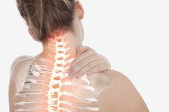 Highlighted spine of woman with neck pain. Digital composite of Highlighted spine of woman with neck pain royalty free stock photos