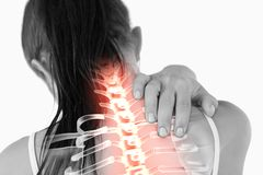 Highlighted spine of woman with neck pain Royalty Free Stock Photography