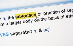 Highlighted word advocacy. Definition in a dictionary royalty free stock photos