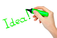 Highlighter in hand and word idea Royalty Free Stock Image