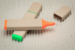 Highlighter pen. A highlighter pen made of paper. Environmentally friendly stationary supplies Royalty Free Stock Photography