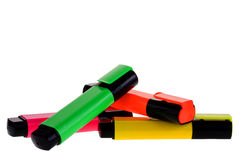 Highlighter pens. Selection of pens with very bright colours n a plain ackground royalty free stock photo
