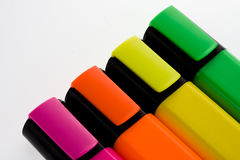 Highlighter pens. Selection of pens with very bright colours n a plain ackground royalty free stock photography