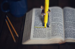 Highlighter study. A man uses a highlighter to study the Bible Royalty Free Stock Photos