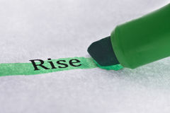 Highlighter and the word 'rise'. Concept business background stock photo