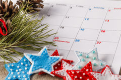 Highlighting christmas date on calendar Stock Photos