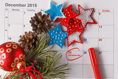 Highlighting christmas date on calendar Stock Images