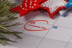 Highlighting christmas date on calendar Stock Photos