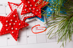 Highlighting christmas date on calendar Stock Images
